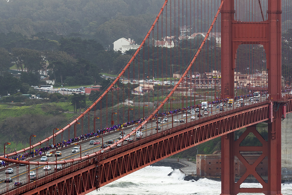 Thousands of people form a human chain across the Golden Gate Bridge
